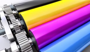 CMYK rollers on a printer | Print Media For Law Firms